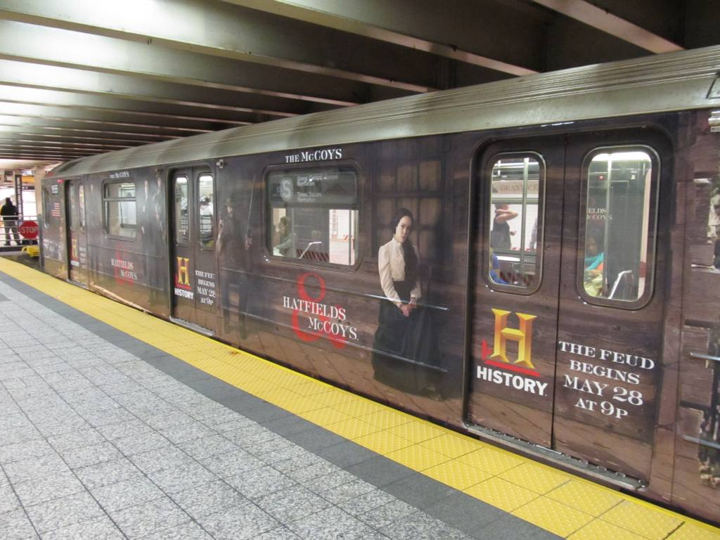 (119k, 1024x768)<br><b>Country:</b> United States<br><b>City:</b> New York<br><b>System:</b> New York City Transit<br><b>Line:</b> IRT Times Square-Grand Central Shuttle<br><b>Location:</b> Grand Central <br><b>Route:</b> S<br><b>Car:</b> R-62A (Bombardier, 1984-1987)  1933 <br><b>Photo by:</b> Robbie Rosenfeld<br><b>Date:</b> 5/22/2012<br><b>Notes:</b> Hatfields-McCoys wrap.<br><b>Viewed (this week/total):</b> 0 / 539