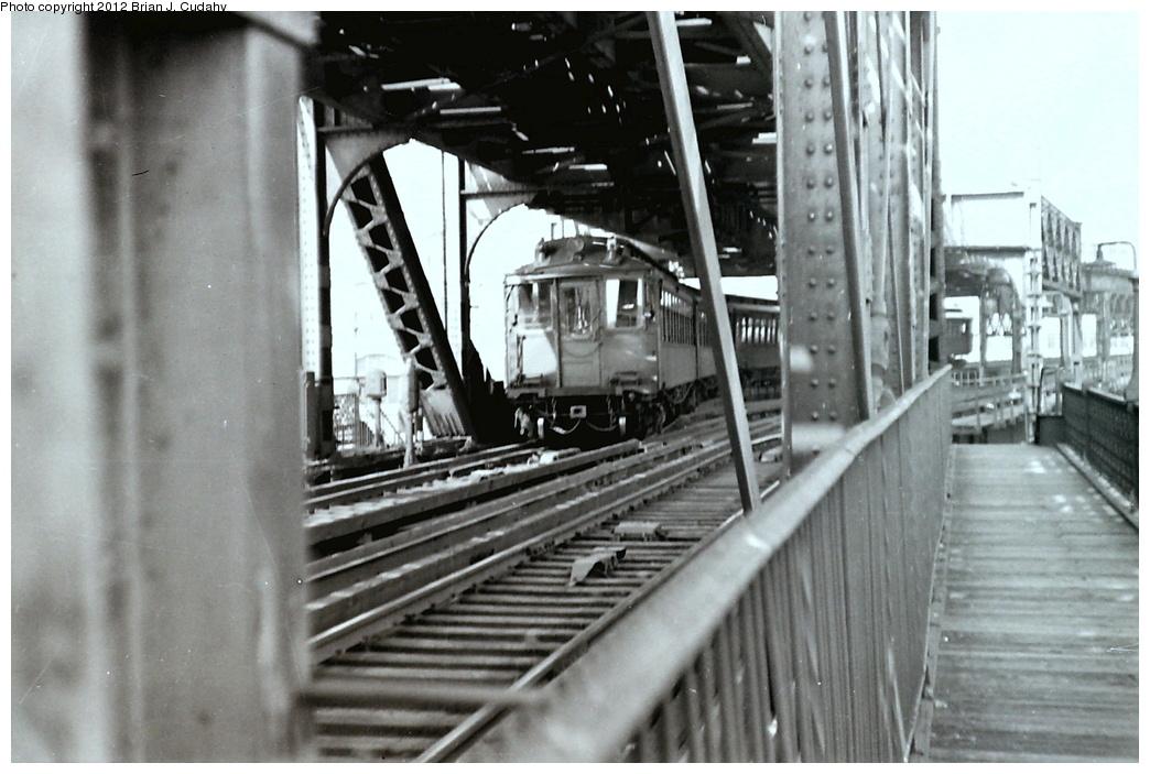 (274k, 1044x703)<br><b>Country:</b> United States<br><b>City:</b> New York<br><b>System:</b> New York City Transit<br><b>Line:</b> 3rd Avenue El<br><b>Location:</b> Harlem River Bridge<br><b>Photo by:</b> Brian J. Cudahy<br><b>Date:</b> 4/1955<br><b>Viewed (this week/total):</b> 9 / 1157