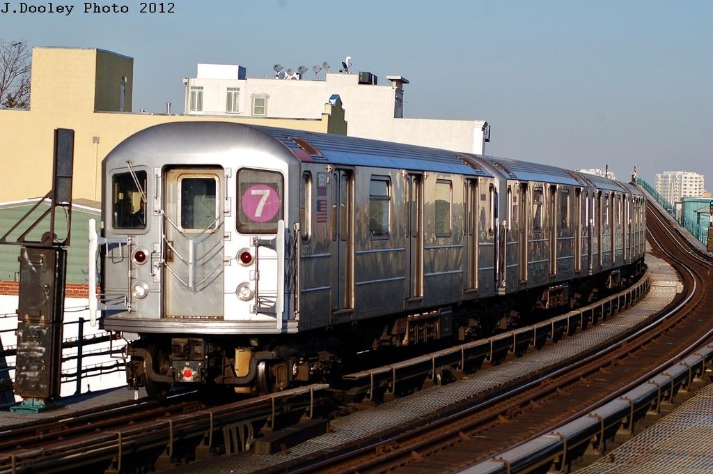 (319k, 1024x680)<br><b>Country:</b> United States<br><b>City:</b> New York<br><b>System:</b> New York City Transit<br><b>Line:</b> IRT Flushing Line<br><b>Location:</b> 103rd Street/Corona Plaza <br><b>Route:</b> 7<br><b>Car:</b> R-62A (Bombardier, 1984-1987)  1681 <br><b>Photo by:</b> John Dooley<br><b>Date:</b> 3/6/2012<br><b>Viewed (this week/total):</b> 0 / 921