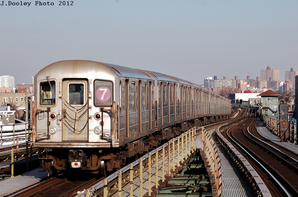 (366k, 1024x677)<br><b>Country:</b> United States<br><b>City:</b> New York<br><b>System:</b> New York City Transit<br><b>Line:</b> IRT Flushing Line<br><b>Location:</b> Junction Boulevard <br><b>Route:</b> 7<br><b>Car:</b> R-62A (Bombardier, 1984-1987)  1695 <br><b>Photo by:</b> John Dooley<br><b>Date:</b> 3/6/2012<br><b>Viewed (this week/total):</b> 0 / 840