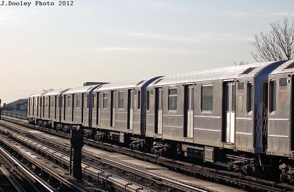 (334k, 1024x667)<br><b>Country:</b> United States<br><b>City:</b> New York<br><b>System:</b> New York City Transit<br><b>Line:</b> IRT Flushing Line<br><b>Location:</b> 103rd Street/Corona Plaza <br><b>Route:</b> 7<br><b>Car:</b> R-62A (Bombardier, 1984-1987)  1705 <br><b>Photo by:</b> John Dooley<br><b>Date:</b> 3/6/2012<br><b>Viewed (this week/total):</b> 0 / 857