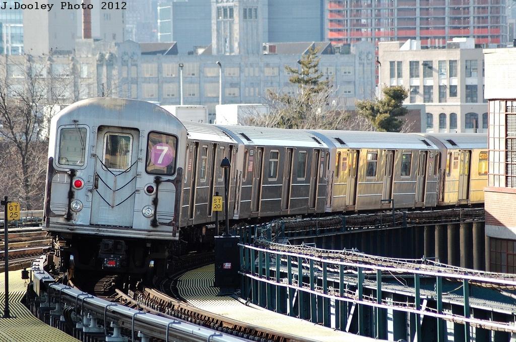(406k, 1024x679)<br><b>Country:</b> United States<br><b>City:</b> New York<br><b>System:</b> New York City Transit<br><b>Line:</b> IRT Flushing Line<br><b>Location:</b> 33rd Street/Rawson Street <br><b>Route:</b> 7<br><b>Car:</b> R-62A (Bombardier, 1984-1987)  1939 <br><b>Photo by:</b> John Dooley<br><b>Date:</b> 3/6/2012<br><b>Viewed (this week/total):</b> 0 / 719