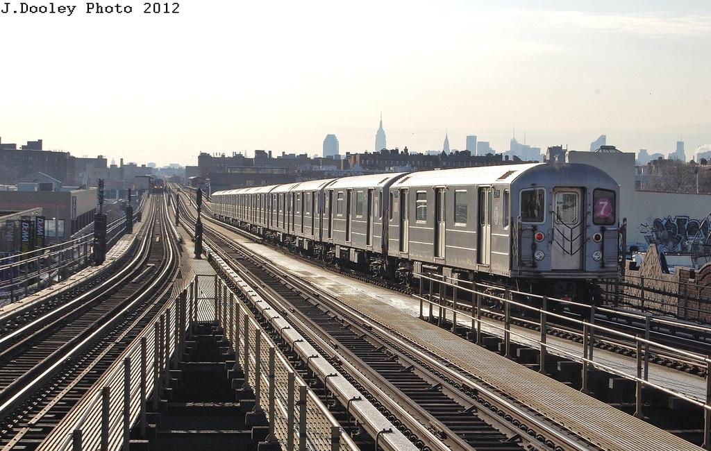 (350k, 1024x650)<br><b>Country:</b> United States<br><b>City:</b> New York<br><b>System:</b> New York City Transit<br><b>Line:</b> IRT Flushing Line<br><b>Location:</b> Junction Boulevard <br><b>Route:</b> 7<br><b>Car:</b> R-62A (Bombardier, 1984-1987)  2114 <br><b>Photo by:</b> John Dooley<br><b>Date:</b> 3/6/2012<br><b>Viewed (this week/total):</b> 0 / 1012