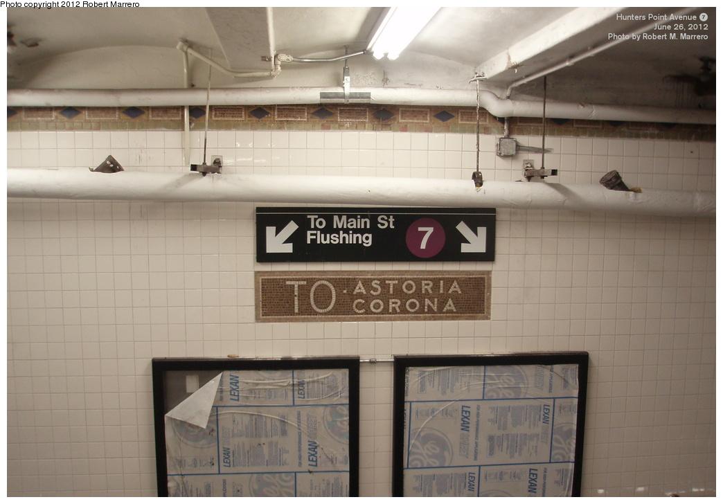 (244k, 1044x728)<br><b>Country:</b> United States<br><b>City:</b> New York<br><b>System:</b> New York City Transit<br><b>Line:</b> IRT Flushing Line<br><b>Location:</b> Hunterspoint Avenue <br><b>Photo by:</b> Robert Marrero<br><b>Date:</b> 6/26/2012<br><b>Notes:</b> To Astoria/Corona mosaic uncovered during renovation.<br><b>Viewed (this week/total):</b> 1 / 1498