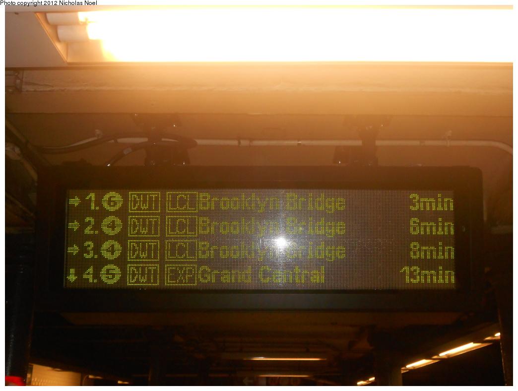 (299k, 1044x788)<br><b>Country:</b> United States<br><b>City:</b> New York<br><b>System:</b> New York City Transit<br><b>Line:</b> IRT East Side Line<br><b>Location:</b> 59th Street <br><b>Photo by:</b> Nicholas Noel<br><b>Date:</b> 4/28/2012<br><b>Notes:</b> Train arrival info on the upper level, downtown platform.<br><b>Viewed (this week/total):</b> 0 / 1535