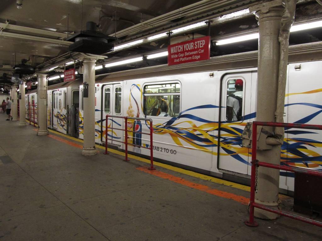 (118k, 1024x768)<br><b>Country:</b> United States<br><b>City:</b> New York<br><b>System:</b> New York City Transit<br><b>Line:</b> IRT Times Square-Grand Central Shuttle<br><b>Location:</b> Times Square <br><b>Route:</b> S<br><b>Car:</b> R-62A (Bombardier, 1984-1987)   <br><b>Photo by:</b> Robbie Rosenfeld<br><b>Date:</b> 7/10/2012<br><b>Notes:</b> Pepsi/Frito-Lay wrap<br><b>Viewed (this week/total):</b> 2 / 1203