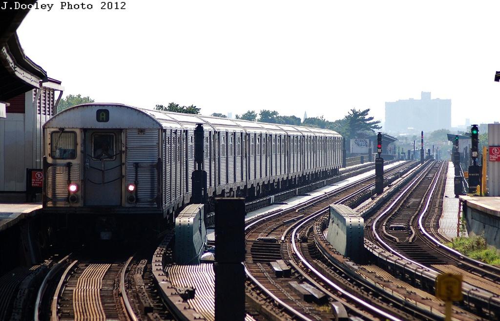 (313k, 1024x658)<br><b>Country:</b> United States<br><b>City:</b> New York<br><b>System:</b> New York City Transit<br><b>Line:</b> IND Fulton Street Line<br><b>Location:</b> Rockaway Boulevard <br><b>Route:</b> A<br><b>Car:</b> R-32 (Budd, 1964)   <br><b>Photo by:</b> John Dooley<br><b>Date:</b> 7/26/2012<br><b>Viewed (this week/total):</b> 0 / 898