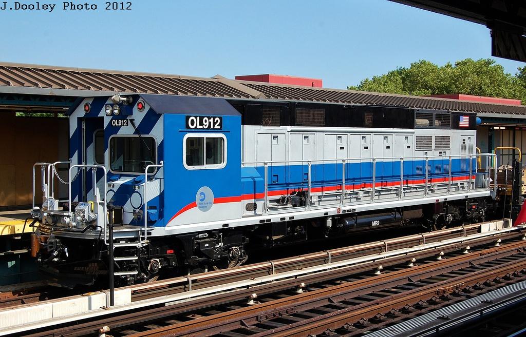 (375k, 1024x657)<br><b>Country:</b> United States<br><b>City:</b> New York<br><b>System:</b> New York City Transit<br><b>Line:</b> BMT West End Line<br><b>Location:</b> Bay 50th Street <br><b>Route:</b> Work Service<br><b>Car:</b> R-156 Diesel-Electric Locomotive (MPI, 2012-2013) 912 <br><b>Photo by:</b> John Dooley<br><b>Date:</b> 7/29/2012<br><b>Viewed (this week/total):</b> 0 / 1520