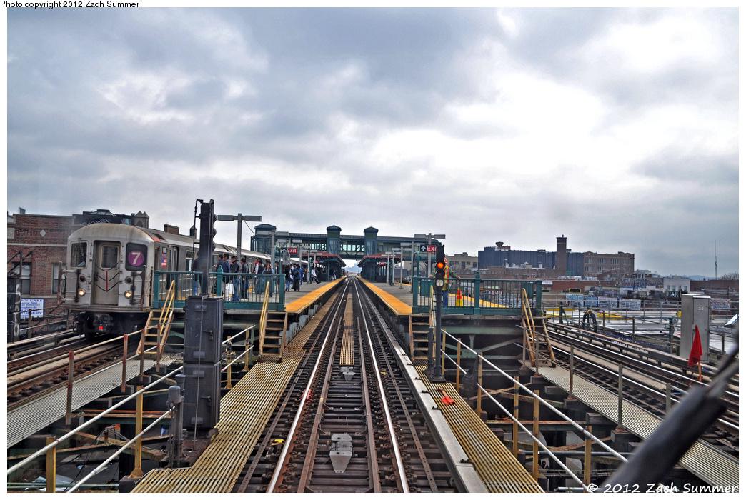 (400k, 1044x700)<br><b>Country:</b> United States<br><b>City:</b> New York<br><b>System:</b> New York City Transit<br><b>Line:</b> IRT Flushing Line<br><b>Location:</b> Junction Boulevard <br><b>Route:</b> 7<br><b>Car:</b> R-62A (Bombardier, 1984-1987)  1661 <br><b>Photo by:</b> Zach Summer<br><b>Date:</b> 3/13/2012<br><b>Viewed (this week/total):</b> 0 / 1403