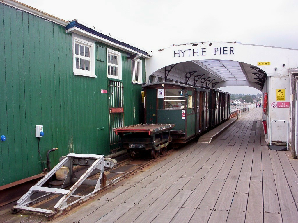 (217k, 1024x768)<br><b>Country:</b> United Kingdom<br><b>City:</b> Hythe, Hampshire<br><b>System:</b> Hythe Pier Railway<br><b>Photo by:</b> Dave Carson<br><b>Date:</b> 7/25/2008<br><b>Notes:</b> The 2-feet gauge Hythe Pier Railway has been connecting with the Hythe-Southampton ferries since 1922, using ex-War Department 1917-built battery locos converted to 3rd rail operation and push-pulling 3 coaches and a luggage truck. It provides a vital link in Southampton's public transport network.<br><b>Viewed (this week/total):</b> 1 / 584