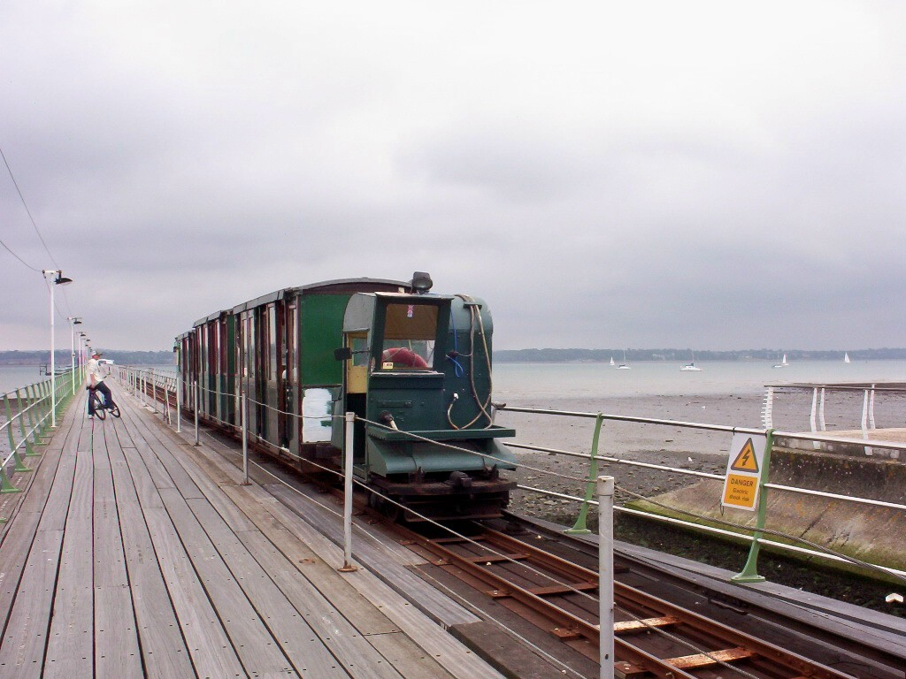 (195k, 1024x768)<br><b>Country:</b> United Kingdom<br><b>City:</b> Hythe, Hampshire<br><b>System:</b> Hythe Pier Railway<br><b>Photo by:</b> Dave Carson<br><b>Date:</b> 8/7/2008<br><b>Notes:</b> The 2-feet gauge Hythe Pier Railway has been connecting with the Hythe-Southampton ferries since 1922, using ex-War Department 1917-built battery locos converted to 3rd rail operation and push-pulling 3 coaches and a luggage truck. It provides a vital link in Southampton's public transport network.<br><b>Viewed (this week/total):</b> 1 / 683