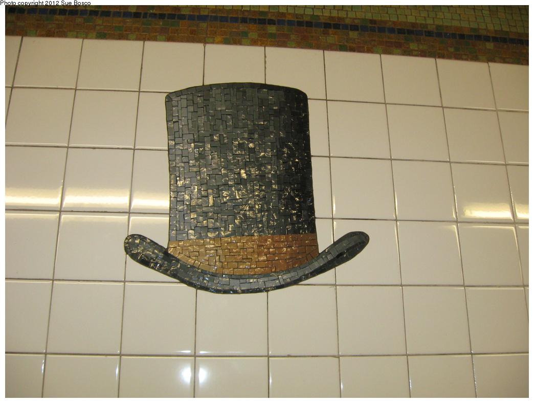 (279k, 1044x788)<br><b>Country:</b> United States<br><b>City:</b> New York<br><b>System:</b> New York City Transit<br><b>Line:</b> BMT Broadway Line<br><b>Location:</b> 23rd Street <br><b>Photo by:</b> Sue Bosco<br><b>Date:</b> 4/25/2012<br><b>Artwork:</b> <i>Memories of Twenty-Third Street</i>, Keith Godard (2002).<br><b>Notes:</b> P.T. Barnum's hat.<br><b>Viewed (this week/total):</b> 2 / 19