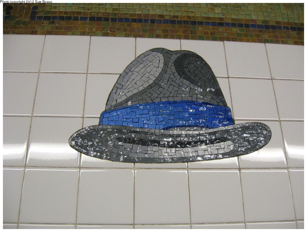 (303k, 1044x788)<br><b>Country:</b> United States<br><b>City:</b> New York<br><b>System:</b> New York City Transit<br><b>Line:</b> BMT Broadway Line<br><b>Location:</b> 23rd Street <br><b>Photo by:</b> Sue Bosco<br><b>Date:</b> 4/25/2012<br><b>Artwork:</b> <i>Memories of Twenty-Third Street</i>, Keith Godard (2002).<br><b>Notes:</b> Charles Ives's hat.<br><b>Viewed (this week/total):</b> 0 / 20