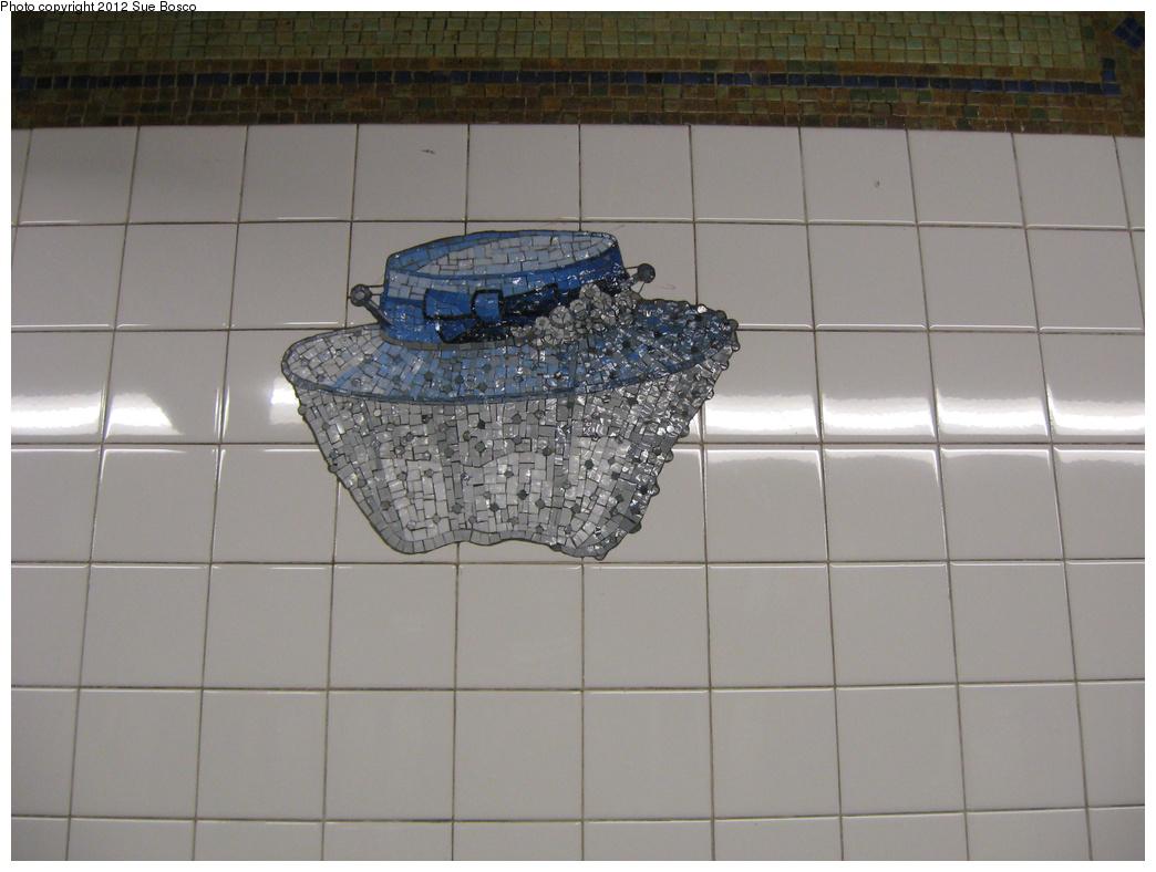 (267k, 1044x788)<br><b>Country:</b> United States<br><b>City:</b> New York<br><b>System:</b> New York City Transit<br><b>Line:</b> BMT Broadway Line<br><b>Location:</b> 23rd Street <br><b>Photo by:</b> Sue Bosco<br><b>Date:</b> 4/25/2012<br><b>Artwork:</b> <i>Memories of Twenty-Third Street</i>, Keith Godard (2002).<br><b>Notes:</b> Eleanor Roosevelt's hat.<br><b>Viewed (this week/total):</b> 2 / 1170