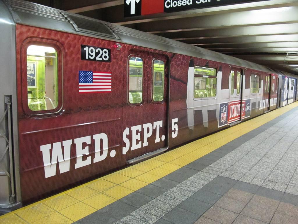 (145k, 1024x768)<br><b>Country:</b> United States<br><b>City:</b> New York<br><b>System:</b> New York City Transit<br><b>Line:</b> IRT Times Square-Grand Central Shuttle<br><b>Location:</b> Grand Central <br><b>Route:</b> S<br><b>Car:</b> R-62A (Bombardier, 1984-1987)  1928 <br><b>Photo by:</b> Robbie Rosenfeld<br><b>Date:</b> 8/27/2012<br><b>Notes:</b> NFL Giants-Cowboys promotion.<br><b>Viewed (this week/total):</b> 0 / 755