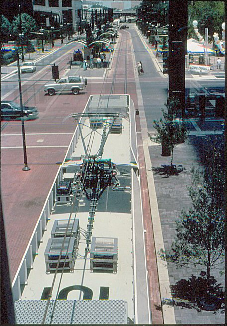 (104k, 456x654)<br><b>Country:</b> United States<br><b>City:</b> Dallas, TX<br><b>System:</b> DART<br><b>Line:</b> DART (Dallas) Red Line/Downtown Trunk<br><b>Location:</b> Pearl/Arts District <br><b>Photo by:</b> Jim Cumbie<br><b>Date:</b> 6/14/1996<br><b>Notes:</b> View from sky bridge of train approaching Pearl Station on Grand Opening Day.<br><b>Viewed (this week/total):</b> 1 / 498