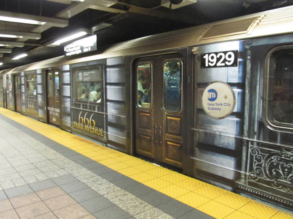 (121k, 1024x768)<br><b>Country:</b> United States<br><b>City:</b> New York<br><b>System:</b> New York City Transit<br><b>Line:</b> IRT Times Square-Grand Central Shuttle<br><b>Location:</b> Grand Central <br><b>Route:</b> S<br><b>Car:</b> R-62A (Bombardier, 1984-1987)  1929 <br><b>Photo by:</b> Robbie Rosenfeld<br><b>Date:</b> 9/27/2012<br><b>Notes:</b> 666 Park Ave tv show wrap.<br><b>Viewed (this week/total):</b> 3 / 697