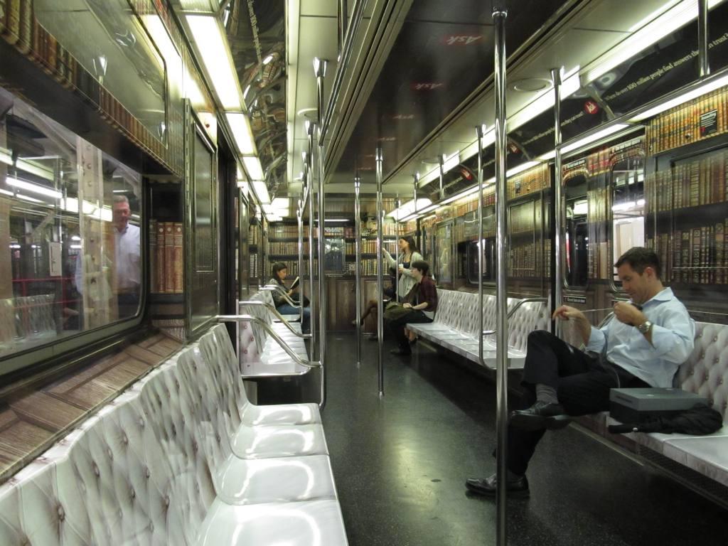 (132k, 1024x768)<br><b>Country:</b> United States<br><b>City:</b> New York<br><b>System:</b> New York City Transit<br><b>Line:</b> IRT Times Square-Grand Central Shuttle<br><b>Location:</b> Grand Central <br><b>Route:</b> S<br><b>Car:</b> R-62A (Bombardier, 1984-1987)  1946 <br><b>Photo by:</b> Robbie Rosenfeld<br><b>Date:</b> 9/27/2012<br><b>Notes:</b> Ask.com ad wrap.<br><b>Viewed (this week/total):</b> 1 / 677