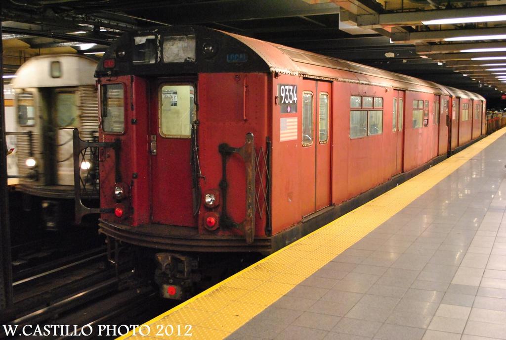 (291k, 1024x687)<br><b>Country:</b> United States<br><b>City:</b> New York<br><b>System:</b> New York City Transit<br><b>Line:</b> IND 8th Avenue Line<br><b>Location:</b> 14th Street <br><b>Route:</b> Work Service<br><b>Car:</b> R-33 World's Fair (St. Louis, 1963-64) 9334 <br><b>Photo by:</b> Wilfredo Castillo<br><b>Date:</b> 10/14/2012<br><b>Viewed (this week/total):</b> 3 / 1054