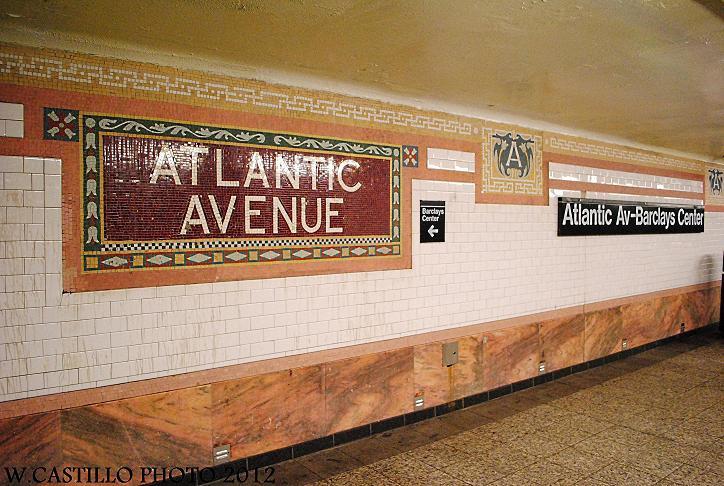 (144k, 724x486)<br><b>Country:</b> United States<br><b>City:</b> New York<br><b>System:</b> New York City Transit<br><b>Line:</b> IRT Brooklyn Line<br><b>Location:</b> Atlantic Avenue <br><b>Photo by:</b> Wilfredo Castillo<br><b>Date:</b> 10/22/2012<br><b>Notes:</b> New name signage alongside restored mosaics.<br><b>Viewed (this week/total):</b> 3 / 975