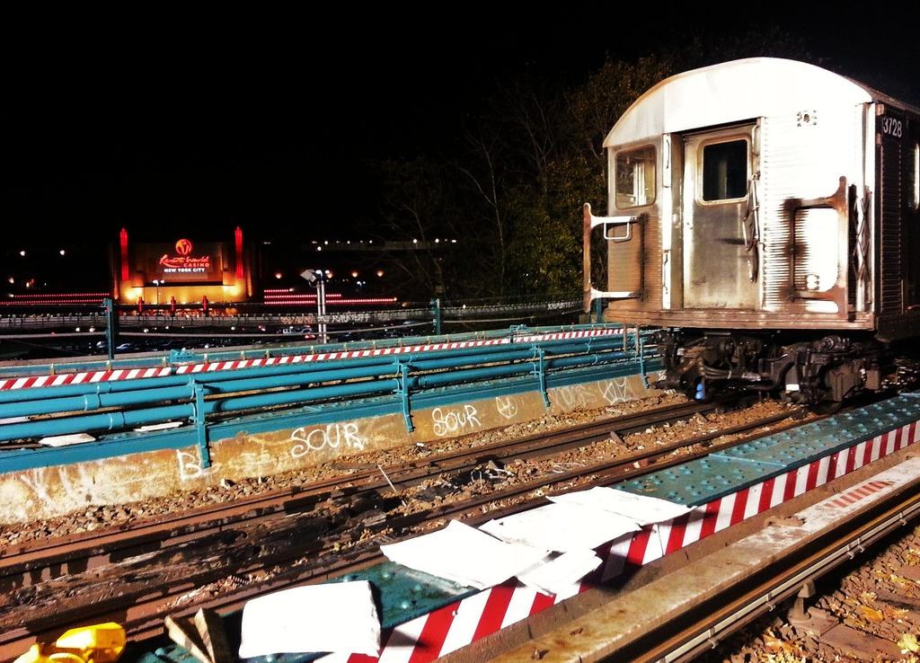 (347k, 1024x738)<br><b>Country:</b> United States<br><b>City:</b> New York<br><b>System:</b> New York City Transit<br><b>Line:</b> IND Rockaway<br><b>Location:</b> Aqueduct Racetrack <br><b>Car:</b> R-32 (Budd, 1964)  3728 <br><b>Photo by:</b> John Dooley<br><b>Date:</b> 11/15/2012<br><b>Notes:</b> R-32 cars being lifted to trucks to move to Rockaway Park.<br><b>Viewed (this week/total):</b> 3 / 1185