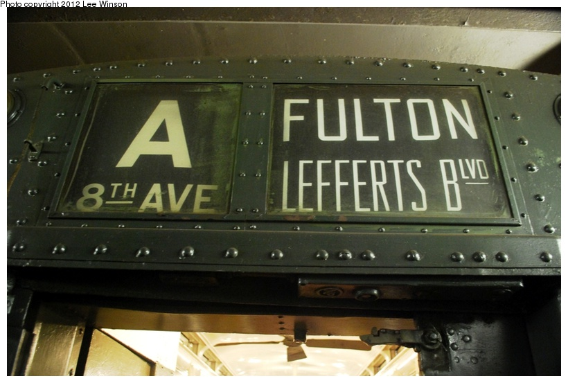 (179k, 820x553)<br><b>Country:</b> United States<br><b>City:</b> New York<br><b>System:</b> New York City Transit<br><b>Route:</b> Museum Train Service<br><b>Car:</b> R-1 (American Car & Foundry, 1930-1931) 100 <br><b>Photo by:</b> Lee Winson<br><b>Date:</b> 12/2/2012<br><b>Notes:</b> Roll sign.<br><b>Viewed (this week/total):</b> 1 / 537
