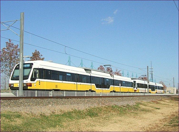 (97k, 752x555)<br><b>Country:</b> United States<br><b>City:</b> Dallas, TX<br><b>System:</b> DART<br><b>Line:</b> DART (Dallas) Blue Line Branches<br><b>Location:</b> Downtown Rowlett <br><b>Car:</b>  184 <br><b>Photo by:</b> Jim Cumbie<br><b>Date:</b> 12/3/2012<br><b>Notes:</b> First day of service on Blue Line to Rowlett.<br><b>Viewed (this week/total):</b> 2 / 826