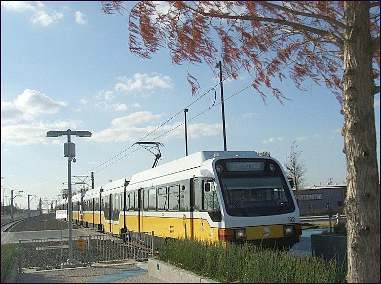 (116k, 752x560)<br><b>Country:</b> United States<br><b>City:</b> Dallas, TX<br><b>System:</b> DART<br><b>Line:</b> DART (Dallas) Blue Line Branches<br><b>Location:</b> Downtown Rowlett <br><b>Car:</b>  132 <br><b>Photo by:</b> Jim Cumbie<br><b>Date:</b> 12/3/2012<br><b>Notes:</b> First day of service on Blue Line to Rowlett.<br><b>Viewed (this week/total):</b> 2 / 710