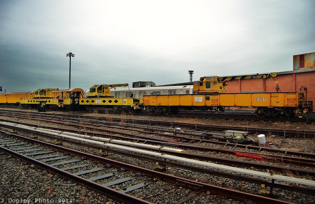 (372k, 1024x663)<br><b>Country:</b> United States<br><b>City:</b> New York<br><b>System:</b> New York City Transit<br><b>Location:</b> Coney Island Yard<br><b>Car:</b> R-73 Telescoping Boom Crane (Fuji, 1984)  257 <br><b>Photo by:</b> John Dooley<br><b>Date:</b> 12/9/2012<br><b>Viewed (this week/total):</b> 1 / 884