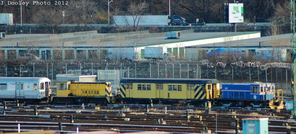 (302k, 1024x466)<br><b>Country:</b> United States<br><b>City:</b> New York<br><b>System:</b> New York City Transit<br><b>Location:</b> 207th Street Yard<br><b>Car:</b> R-41 Locomotive  57 <br><b>Photo by:</b> John Dooley<br><b>Date:</b> 12/11/2012<br><b>Notes:</b> With RD417, Loco 53, scrap R-44s<br><b>Viewed (this week/total):</b> 2 / 609