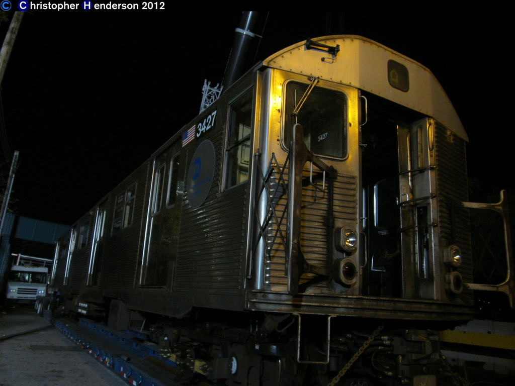 (201k, 1024x768)<br><b>Country:</b> United States<br><b>City:</b> New York<br><b>System:</b> New York City Transit<br><b>Line:</b> IND Rockaway<br><b>Location:</b> Aqueduct Racetrack <br><b>Car:</b> R-32 (Budd, 1964)  3427 <br><b>Photo by:</b> Christopher Henderson<br><b>Date:</b> 11/6/202012<br><b>Notes:</b> Trucking cars to the Rockaways post-Sandy<br><b>Viewed (this week/total):</b> 1 / 984