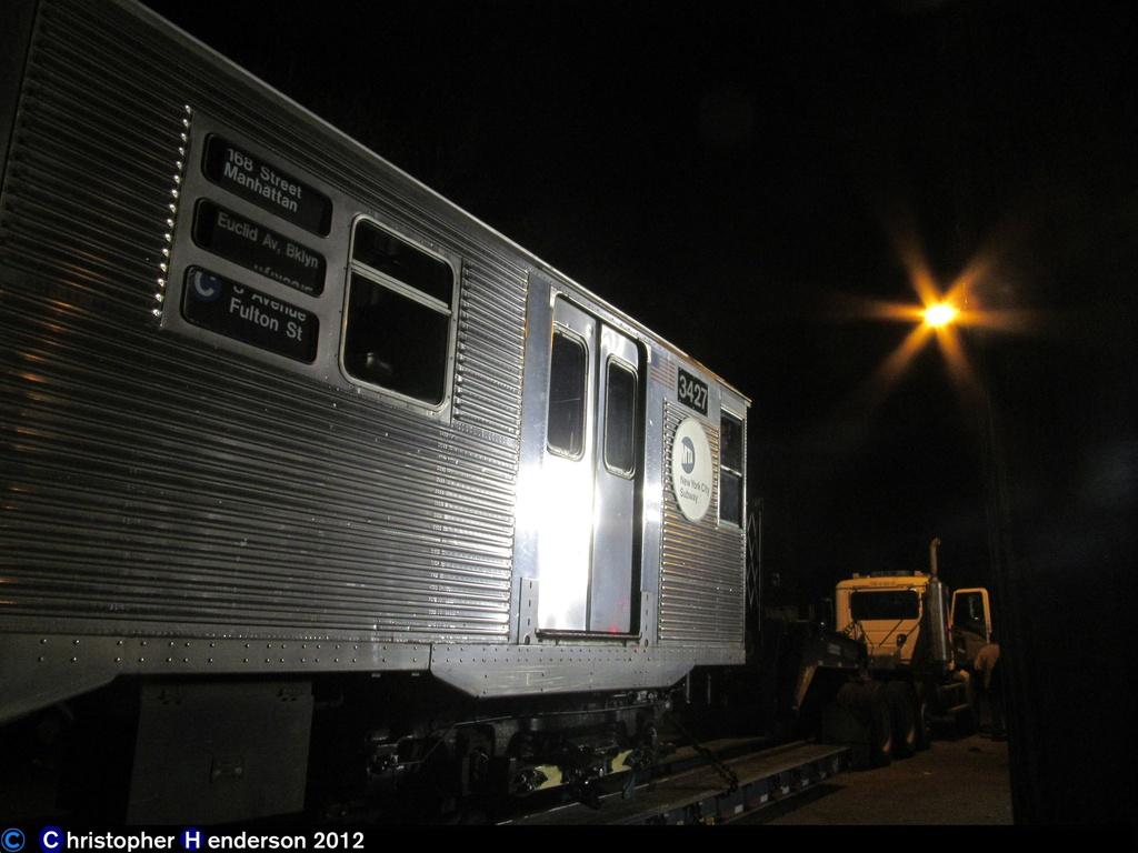(228k, 1024x768)<br><b>Country:</b> United States<br><b>City:</b> New York<br><b>System:</b> New York City Transit<br><b>Line:</b> IND Rockaway<br><b>Location:</b> Aqueduct Racetrack <br><b>Car:</b> R-32 (Budd, 1964)  3427 <br><b>Photo by:</b> Christopher Henderson<br><b>Date:</b> 11/6/202012<br><b>Notes:</b> Trucking cars to the Rockaways post-Sandy<br><b>Viewed (this week/total):</b> 2 / 1201