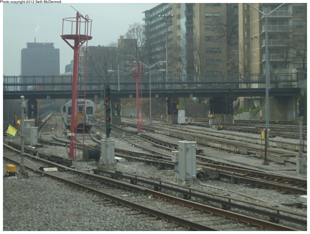 (295k, 1044x788)<br><b>Country:</b> Canada<br><b>City:</b> Toronto<br><b>System:</b> TTC<br><b>Line:</b> TTC Yonge-University-Spadina Subway<br><b>Location:</b> Davisville <br><b>Photo by:</b> Seth McDermott<br><b>Date:</b> 12/3/2012<br><b>Notes:</b> Yonge Line ROW south of Davisville, seen from the front window of car 5249 travelling southbound ... yard storage tracks to the right The footbridge over the yard is the former Toronto Belt Line Railway bridge, now part of the Kay Gardner Beltline Park.<br><b>Viewed (this week/total):</b> 1 / 443
