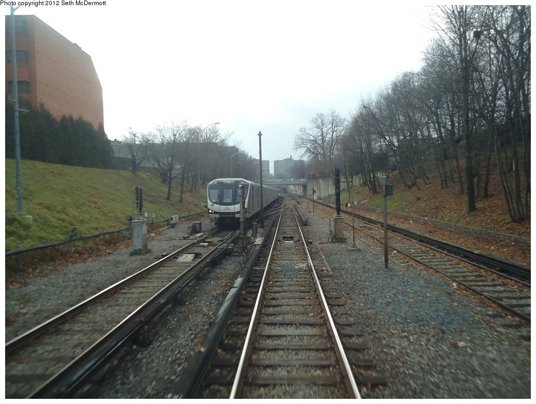 (312k, 1044x788)<br><b>Country:</b> Canada<br><b>City:</b> Toronto<br><b>System:</b> TTC<br><b>Line:</b> TTC Yonge-University-Spadina Subway<br><b>Location:</b> Eglinton <br><b>Photo by:</b> Seth McDermott<br><b>Date:</b> 12/3/2012<br><b>Notes:</b> Yonge Line ROW south of Eglinton, seen from a southbound train ... northbound TR train, Imperial Street bridge, and turnout to Davisville Yard ahead<br><b>Viewed (this week/total):</b> 3 / 623