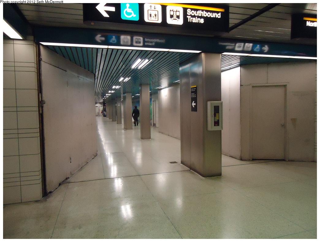 (284k, 1044x788)<br><b>Country:</b> Canada<br><b>City:</b> Toronto<br><b>System:</b> TTC<br><b>Line:</b> TTC Yonge-University-Spadina Subway<br><b>Location:</b> North York Centre <br><b>Photo by:</b> Seth McDermott<br><b>Date:</b> 12/3/2012<br><b>Notes:</b> Passage between auxiliary and main fare controls in mezzanine<br><b>Viewed (this week/total):</b> 0 / 364