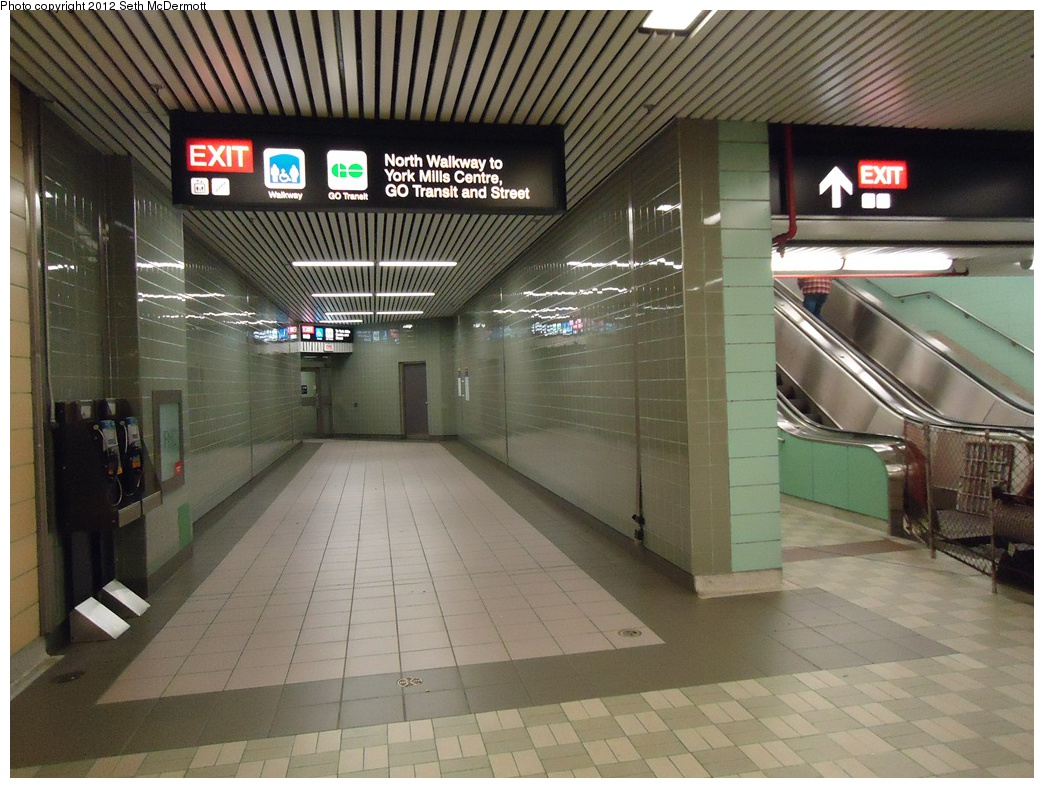 (320k, 1044x788)<br><b>Country:</b> Canada<br><b>City:</b> Toronto<br><b>System:</b> TTC<br><b>Line:</b> TTC Yonge-University-Spadina Subway<br><b>Location:</b> York Mills <br><b>Photo by:</b> Seth McDermott<br><b>Date:</b> 12/6/2012<br><b>Notes:</b> York Mills mezzanine ... accessibility retrofit connecting to the York Mills Centre The signage refers to GO Transit. GO (originally named after the Government of Ontario) operates commuter trains and buses in the greater Toronto area. GO fares are separate from TTC fares. Some GO bus routes operate to this station, outside of the TTC's fare-paid area.<br><b>Viewed (this week/total):</b> 0 / 334