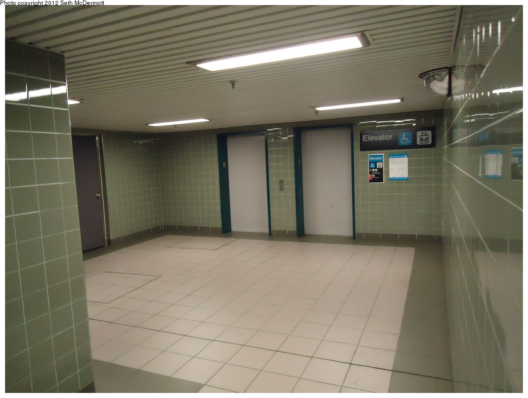 (253k, 1044x788)<br><b>Country:</b> Canada<br><b>City:</b> Toronto<br><b>System:</b> TTC<br><b>Line:</b> TTC Yonge-University-Spadina Subway<br><b>Location:</b> York Mills <br><b>Photo by:</b> Seth McDermott<br><b>Date:</b> 12/6/2012<br><b>Notes:</b> Elevators to the York Mills Centre, from the mezzanine level<br><b>Viewed (this week/total):</b> 0 / 320