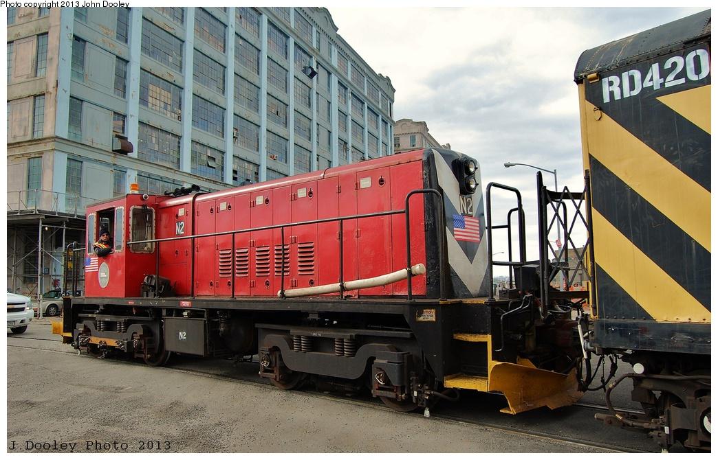 (359k, 1044x670)<br><b>Country:</b> United States<br><b>City:</b> New York<br><b>System:</b> New York City Transit<br><b>Line:</b> South Brooklyn Railway<br><b>Location:</b> 1st Avenue & 39th St (SBK)<br><b>Route:</b> Work Service<br><b>Car:</b> R-47 (SBK) Locomotive  N2 <br><b>Photo by:</b> John Dooley<br><b>Date:</b> 2/6/2013<br><b>Notes:</b> Delivery of new R-156 OL913 locomotive.<br><b>Viewed (this week/total):</b> 1 / 879