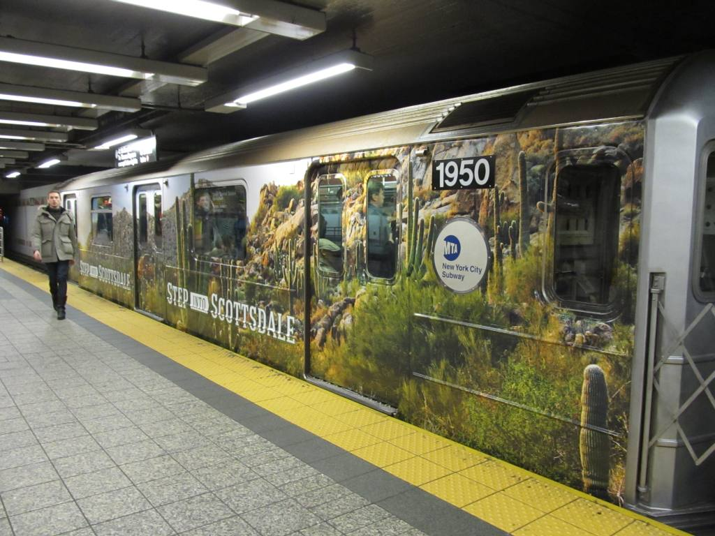 (132k, 1024x768)<br><b>Country:</b> United States<br><b>City:</b> New York<br><b>System:</b> New York City Transit<br><b>Line:</b> IRT Times Square-Grand Central Shuttle<br><b>Location:</b> Grand Central <br><b>Route:</b> S<br><b>Car:</b> R-62A (Bombardier, 1984-1987)  1950 <br><b>Photo by:</b> Robbie Rosenfeld<br><b>Date:</b> 2/6/2013<br><b>Notes:</b> Scottzdale, AZ tourism ad wrap<br><b>Viewed (this week/total):</b> 0 / 612