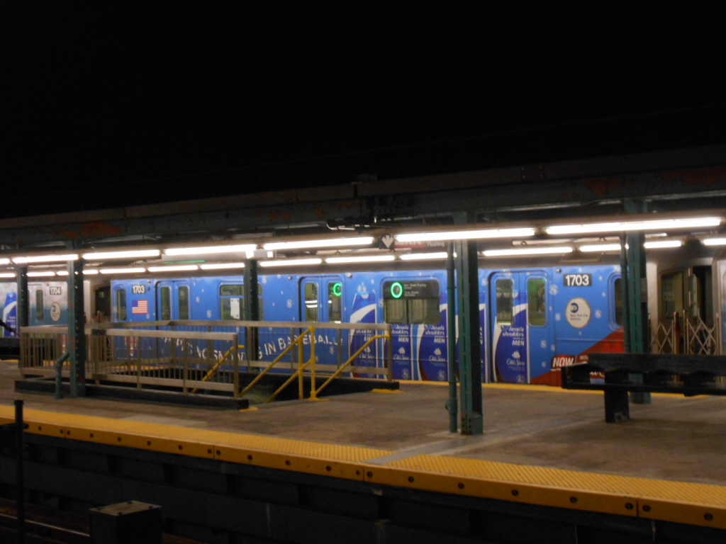 (316k, 1024x768)<br><b>Country:</b> United States<br><b>City:</b> New York<br><b>System:</b> New York City Transit<br><b>Line:</b> IRT Flushing Line<br><b>Location:</b> Willets Point/Mets (fmr. Shea Stadium) <br><b>Route:</b> 7<br><b>Car:</b> R-62A (Bombardier, 1984-1987)  1703 <br><b>Photo by:</b> Gary Chatterton<br><b>Date:</b> 6/11/2013<br><b>Viewed (this week/total):</b> 4 / 1102