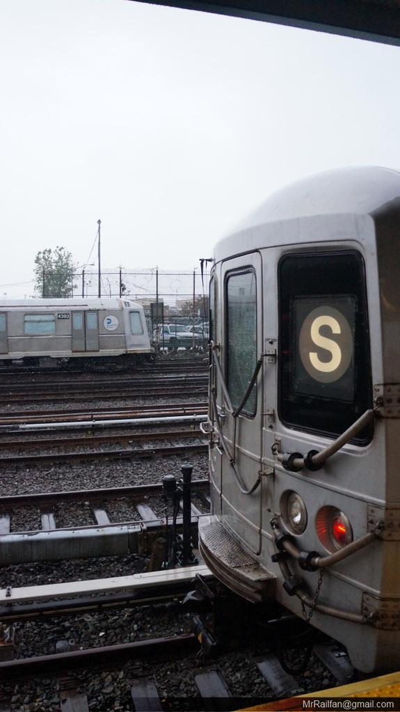 (178k, 575x1023)<br><b>Country:</b> United States<br><b>City:</b> New York<br><b>System:</b> New York City Transit<br><b>Line:</b> IND Rockaway<br><b>Location:</b> Rockaway Park/Beach 116th Street <br><b>Route:</b> S<br><b>Car:</b> R-46 (Pullman-Standard, 1974-75)  <br><b>Photo by:</b> Mr. Railfan <br><b>Date:</b> 6/13/2013<br><b>Notes:</b> With R40 school car<br><b>Viewed (this week/total):</b> 0 / 889