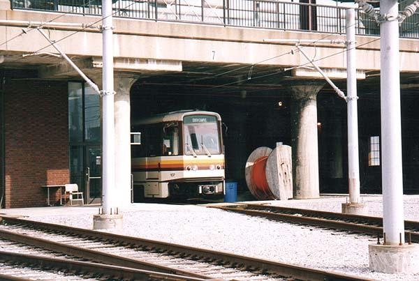 (51k, 600x403)<br><b>Country:</b> United States<br><b>City:</b> Buffalo, NY<br><b>System:</b> NFTA-Metro<br><b>Car:</b>  117 <br><b>Photo by:</b> Rob Hutchinson<br><b>Date:</b> 8/2000<br><b>Notes:</b> Car 117 is poking out of the carhouse, located at the south end of the route.  It is a former Erie/Lackawanna depot.<br><b>Viewed (this week/total):</b> 0 / 6295