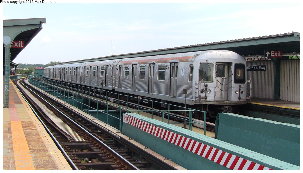 (276k, 1044x596)<br><b>Country:</b> United States<br><b>City:</b> New York<br><b>System:</b> New York City Transit<br><b>Line:</b> BMT Nassau Street/Jamaica Line<br><b>Location:</b> 85th Street/Forest Parkway <br><b>Route:</b> J<br><b>Car:</b> R-42 (St. Louis, 1969-1970)  4823 <br><b>Photo by:</b> Max Diamond<br><b>Date:</b> 7/27/2013<br><b>Viewed (this week/total):</b> 0 / 1182