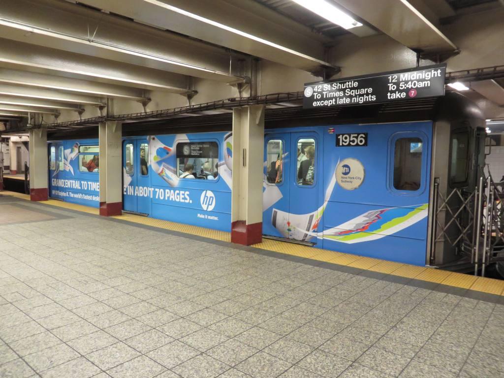 (140k, 1024x768)<br><b>Country:</b> United States<br><b>City:</b> New York<br><b>System:</b> New York City Transit<br><b>Line:</b> IRT Times Square-Grand Central Shuttle<br><b>Location:</b> Grand Central <br><b>Route:</b> S<br><b>Car:</b> R-62A (Bombardier, 1984-1987)  1956 <br><b>Photo by:</b> Robbie Rosenfeld<br><b>Date:</b> 8/20/2013<br><b>Notes:</b> HP ad wrap.<br><b>Viewed (this week/total):</b> 1 / 760