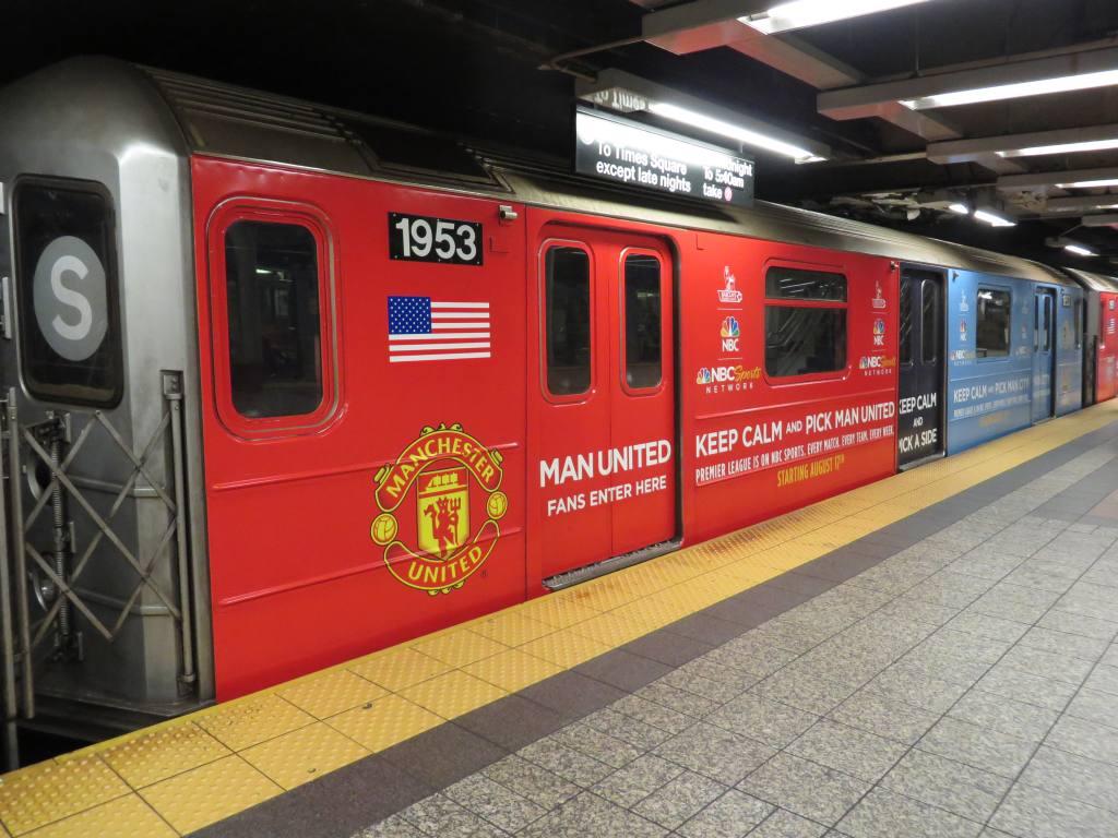 (128k, 1024x768)<br><b>Country:</b> United States<br><b>City:</b> New York<br><b>System:</b> New York City Transit<br><b>Line:</b> IRT Times Square-Grand Central Shuttle<br><b>Location:</b> Grand Central <br><b>Route:</b> S<br><b>Car:</b> R-62A (Bombardier, 1984-1987)  1953 <br><b>Photo by:</b> Robbie Rosenfeld<br><b>Date:</b> 8/11/2013<br><b>Notes:</b> NBC sports soccer wrap.<br><b>Viewed (this week/total):</b> 0 / 1091