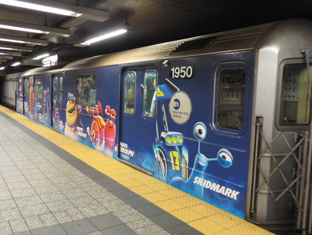 (120k, 1024x770)<br><b>Country:</b> United States<br><b>City:</b> New York<br><b>System:</b> New York City Transit<br><b>Line:</b> IRT Times Square-Grand Central Shuttle<br><b>Location:</b> Grand Central <br><b>Route:</b> S<br><b>Car:</b> R-62A (Bombardier, 1984-1987)  1950 <br><b>Photo by:</b> Robbie Rosenfeld<br><b>Date:</b> 7/3/2013<br><b>Notes:</b> Turbo movie ad wrap<br><b>Viewed (this week/total):</b> 0 / 836
