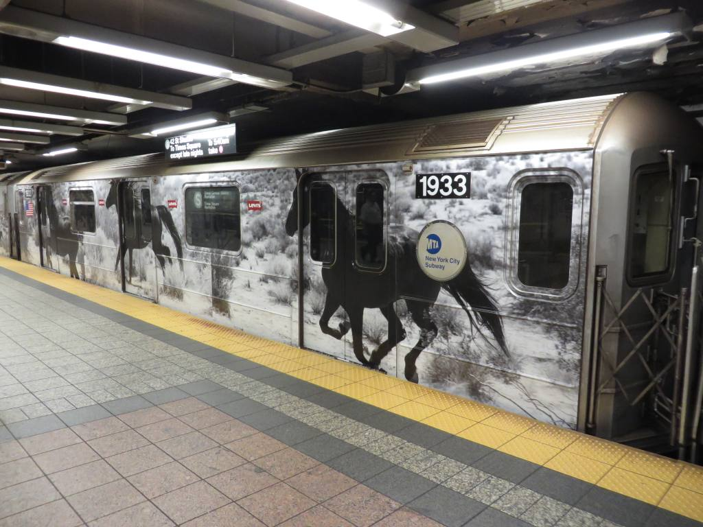 (127k, 1024x768)<br><b>Country:</b> United States<br><b>City:</b> New York<br><b>System:</b> New York City Transit<br><b>Line:</b> IRT Times Square-Grand Central Shuttle<br><b>Location:</b> Grand Central <br><b>Route:</b> S<br><b>Car:</b> R-62A (Bombardier, 1984-1987)  1933 <br><b>Photo by:</b> Robbie Rosenfeld<br><b>Date:</b> 9/15/2013<br><b>Notes:</b> Levis ad wrap<br><b>Viewed (this week/total):</b> 0 / 603