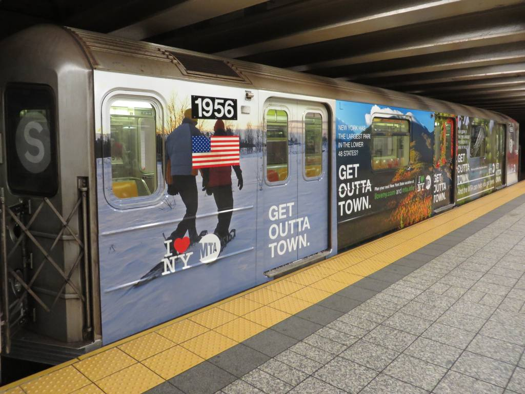 (130k, 1024x768)<br><b>Country:</b> United States<br><b>City:</b> New York<br><b>System:</b> New York City Transit<br><b>Line:</b> IRT Times Square-Grand Central Shuttle<br><b>Location:</b> Grand Central <br><b>Route:</b> S<br><b>Car:</b> R-62A (Bombardier, 1984-1987)  1956 <br><b>Photo by:</b> Robbie Rosenfeld<br><b>Date:</b> 10/20/2013<br><b>Notes:</b> MTA Get Outta Town ad wrap<br><b>Viewed (this week/total):</b> 3 / 891