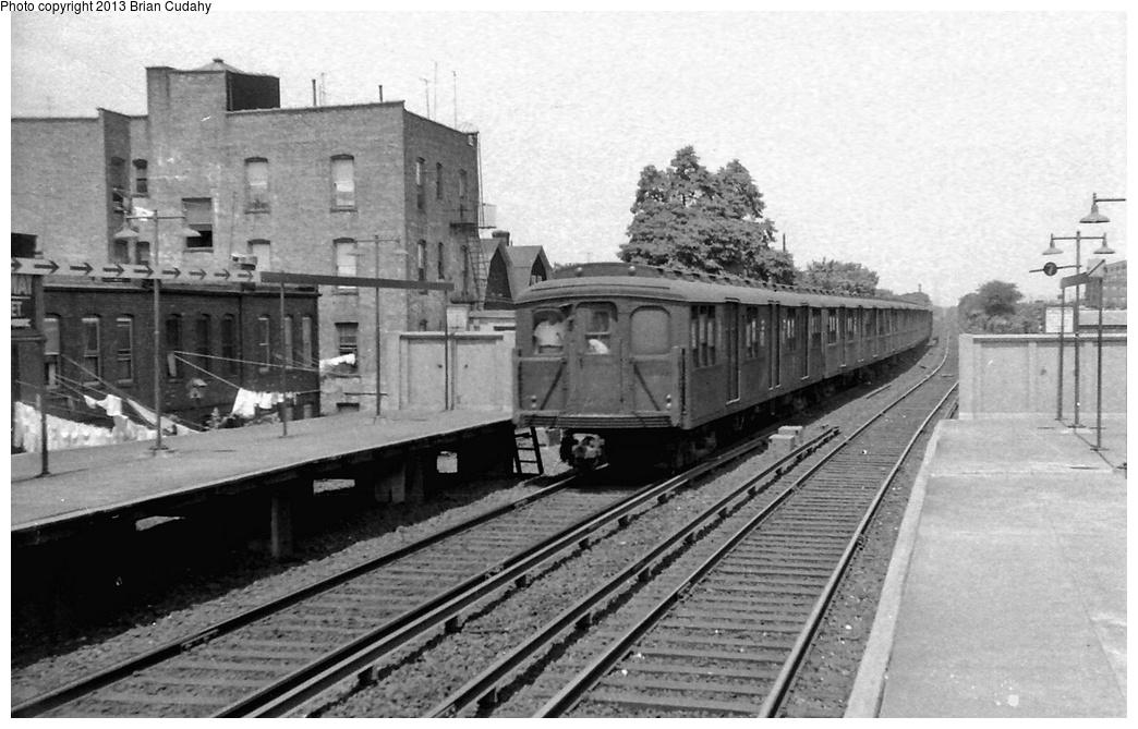 (275k, 1044x669)<br><b>Country:</b> United States<br><b>City:</b> New York<br><b>System:</b> New York City Transit<br><b>Line:</b> BMT Brighton Line<br><b>Location:</b> Kings Highway <br><b>Car:</b> BMT A/B-Type Standard  <br><b>Photo by:</b> Brian J. Cudahy<br><b>Date:</b> 1955<br><b>Notes:</b> Brighton Beach-bound Brighton Express with AB units at Kings Highway in 1955. Note uncovered third rail<br><b>Viewed (this week/total):</b> 0 / 1237