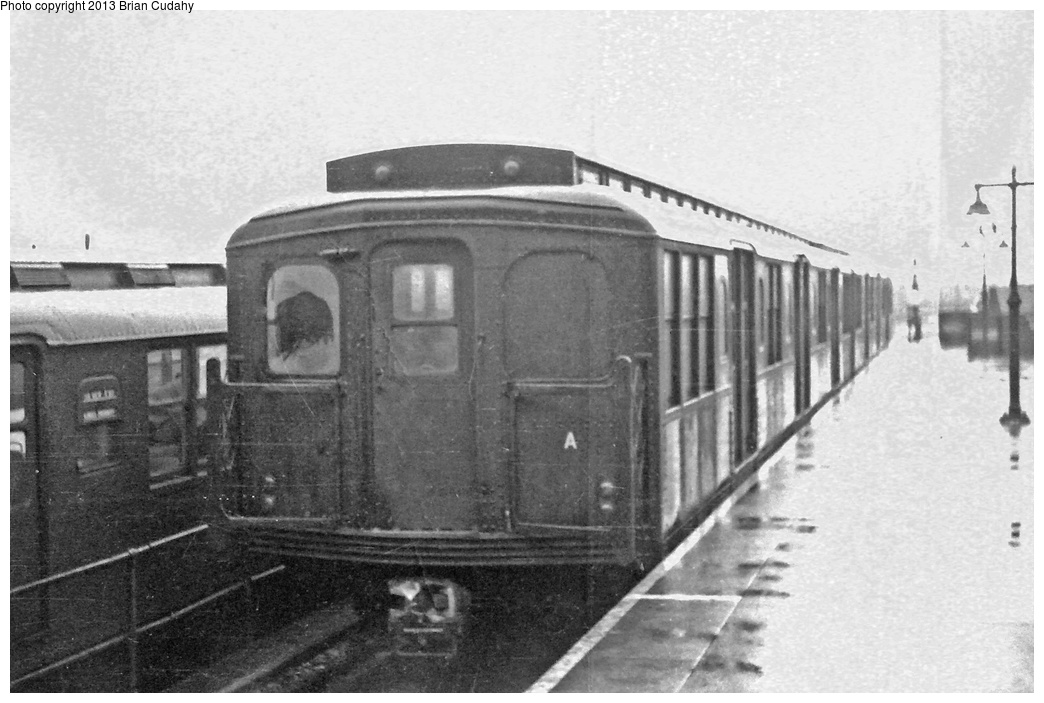 (257k, 1044x703)<br><b>Country:</b> United States<br><b>City:</b> New York<br><b>System:</b> New York City Transit<br><b>Location:</b> Coney Island/Stillwell Avenue<br><b>Car:</b> BMT A/B-Type Standard  <br><b>Photo by:</b> Brian J. Cudahy<br><b>Date:</b> 1954<br><b>Notes:</b> Summer of 1954, a two-car cut of B units waits on Track D at Stillwell Avenue, soon to be coupled onto a six-car train to make an eight-car consist for the evening rush hour. Look closely at the Culver train on Track E. Roll sign reads CULVER EXP. and KINGS HIGHWAY. A three-car midday Culver Local has been expanded into a six-car Culver Express, and on its return trip from lower Manhattan will terminate at Kings Highway and passengers beyond this point will transfer to ex-el cars for the final portion of their trip.<br><b>Viewed (this week/total):</b> 0 / 1613